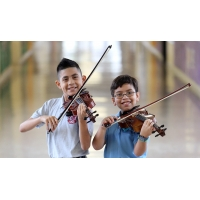 Two boys playing violins
