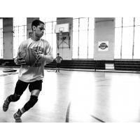 A young man dribbling a basketball
