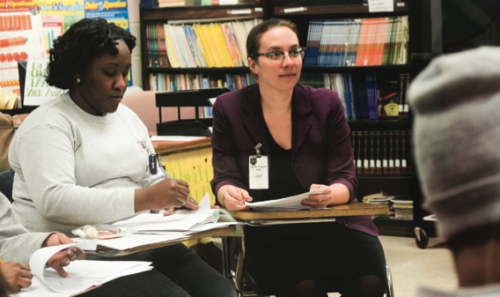 Janet Johnson (left) revises an essay with input from Amy Roza (right) and classmates in GPEP's introductory writing course.