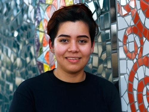 A teenage girl smiling