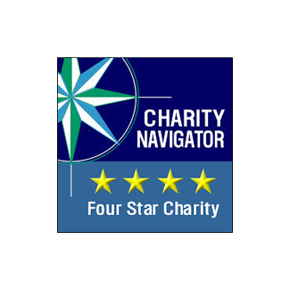 "A rectangular logo with a compass rose and a blue background, with text reading ""Charity Navigator"""