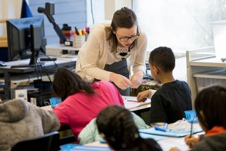 A Teach For America teacher working with elementary students.