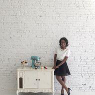 Thomasena Thomas stands at her bakery, Fairycakessc