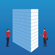 A wall dividing two people, each one standing on opposite sides of the wall.