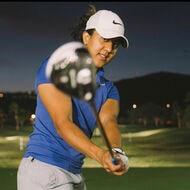 Maya Reddy swinging the golf club toward the camera