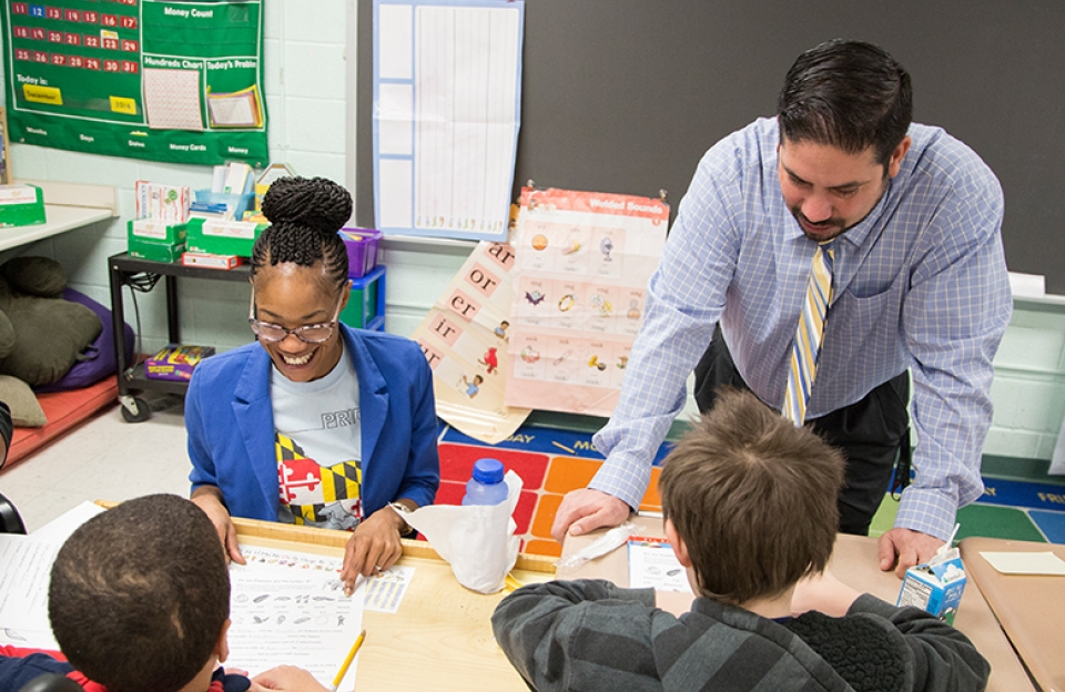 Special education teacher and her principal work with students in a Baltimore, Maryland classroom.