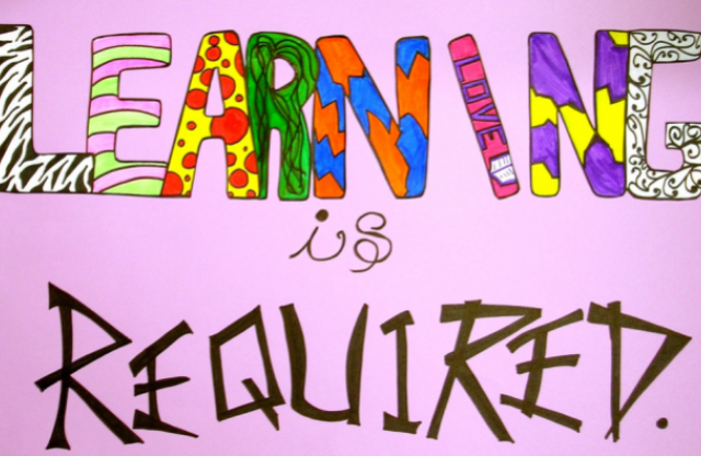 "A rectangular logo with a pink background and colored lettering reading ""learning is required."""