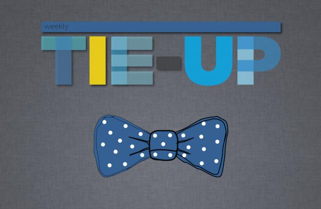 "A rectangular logo with a gray background, featuring a blue bow-tie and blue text reading ""the weekly tie-up."""