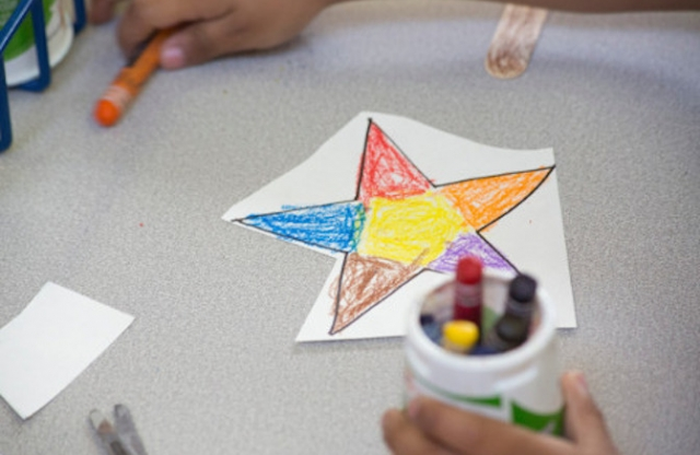 A school art table with a multicolored star with five points.