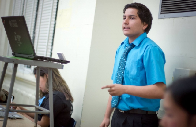 student with shirt and tie speaking