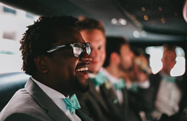 smiling man with sunglasses in limo