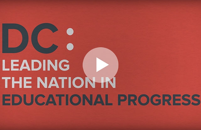 """Screenshot of a video featuring a red background with black and white text reading """"DC: Leading the nation in educational progress."""""""