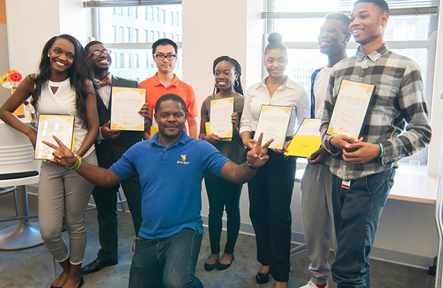 Gabriel Fotsing with students celebrating scholarship awards