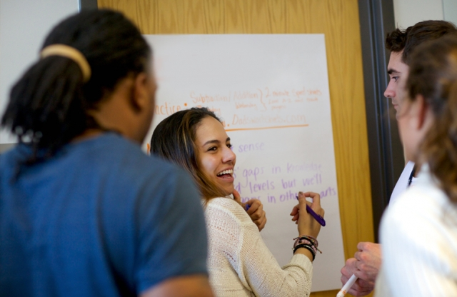 Teach For America corps members and alumni participating in a workshop.