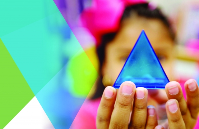 A young girl holding a prism.