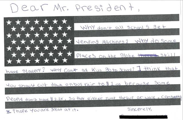 "A child's ""Dear Mr President"" letter on an American flag asking questions about inequality in schools."