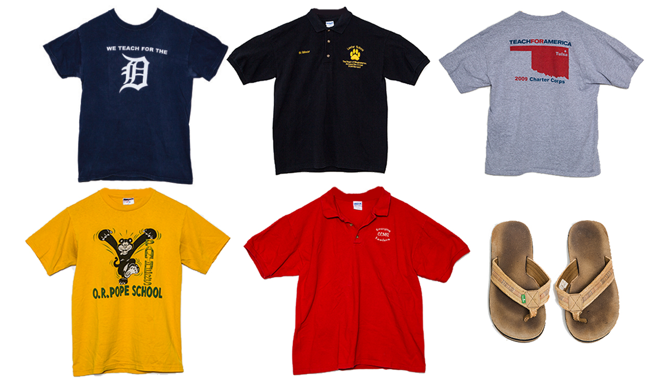 "Six clothing items lined next to each other: a blue t-shirt that read ""We Teach for the D,"" a black polo shirt, a TFA Tulsa 2009 t-shirt, a yellow O.R. Pope School t-shirt, a red polo shirt, and a pair of worn khaki flip-flops."