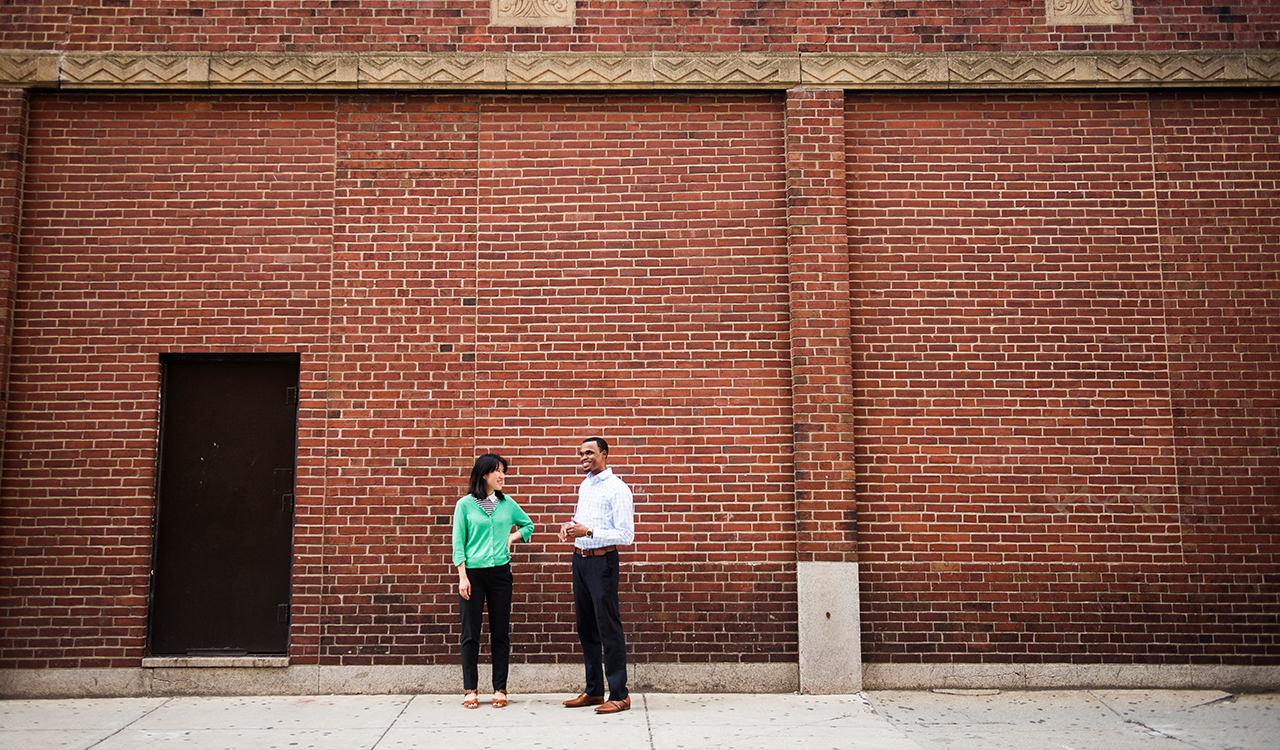 Two people standing in front of a building