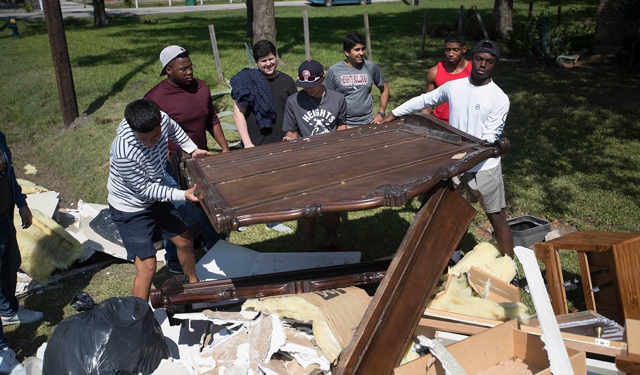 Students load damaged belongings