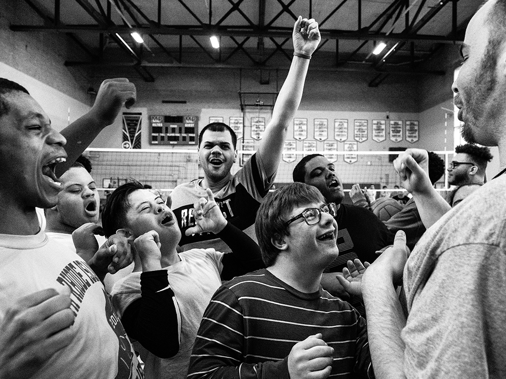 A group of basketball players cheering